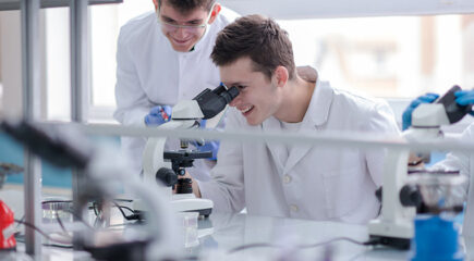 Group of young medical students doing research together in chemistry laboratory,teamwork by college student indoors